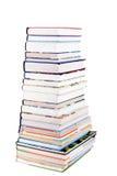 books den färgrika stapeln arkivfoton