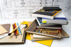 Books on the designer`s desk. Books and pencils on the designer`s desk royalty free stock image