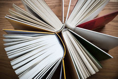 Books on desk Stock Photos