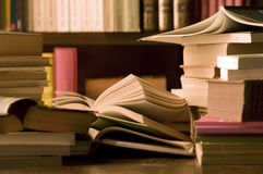 Books on desk and library Royalty Free Stock Images