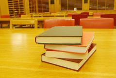 Books on the desk in library stock photo