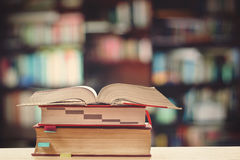 Books on the desk in the library Royalty Free Stock Photo