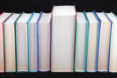Books of different colours. Royalty Free Stock Photos