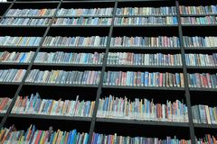 Books in different colours on the shelves in the library. Many books in different colours on the shelves in a part of the municipal library, Boekenberg in the Stock Photography