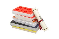 Books and diploma isolated on white Stock Photos