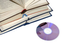 Books and disk. Modern technologies allow to store more information on smaller volume of space stock images
