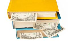 Books with dollar bookmarks Royalty Free Stock Image