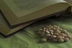 BOOKS OR DRUGS???. Some years ago people read books, but now Royalty Free Stock Images