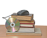 Books, dvd, and mouse Royalty Free Stock Images