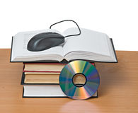 Books, dvd, and mouse Royalty Free Stock Photography