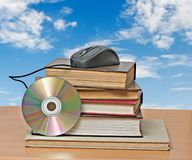 Books, dvd, and mouse Stock Photo