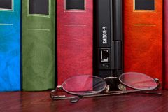Books and e-books. Books and laptop with many e-books inside Stock Photography