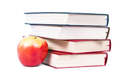Books of each other, next to apples. Royalty Free Stock Photography