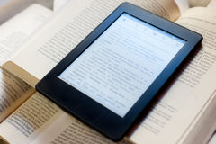 Books and ebook reader Stock Photos