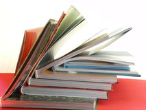 Books education. Back to school with a pile of books for education and study on red surface Stock Images
