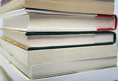 Books End Stacked. Closeup of a stack of books shown on the ends Royalty Free Stock Photo
