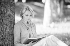 Books every girl should read. Girl concentrated sit park read book nature background. Reading inspiring books. Female. Literature. Relax leisure an hobby royalty free stock images