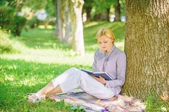 Books every girl should read. Relax leisure an hobby concept. Best self help books for women. Girl concentrated sit park. Lean tree trunk read book. Reading royalty free stock image