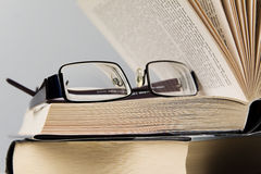 Books and eyeglasses. /selective focus Stock Photo