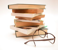 Books and eyeglasses Stock Images