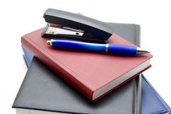 Books with file and ballpoint pen Stock Photo