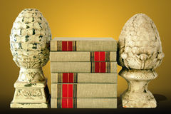 Books with Finials with Gold Background. Stack of books with antique finials with a gold background stock images