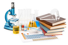 Books and flasks Stock Images