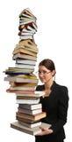books flickan som mycket rymmer den stora stapeln Royaltyfri Bild