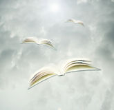 Books in flight Stock Photo