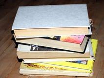 Books on the floor. Books on the wooden floor Stock Image