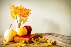 Books and flower with fruit, home decoration concept Stock Photos