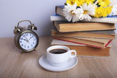 Books flowers and coffee stock image