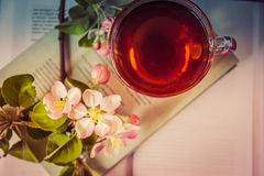 Books, flowers and cup of tea Stock Images