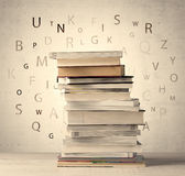 Books with flying letters on vintage background. Books with flying letters on vintage old background Royalty Free Stock Image