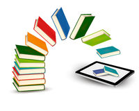 Books flying in a tablet Stock Images