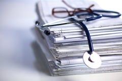 Books folder file and stethoscope isolated on Royalty Free Stock Image