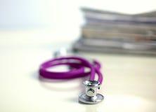 Books folder file and stethoscope isolated on Stock Photo