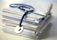 Books folder file and stethoscope isolated on Royalty Free Stock Images