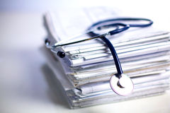 Books folder file and stethoscope  on Stock Photography