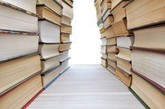Books forming a corridor Stock Images