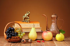 Books and fresh fruits Stock Photos