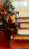 Books in front of Chrismas tree Stock Photography