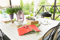 Books on the garden terrace - relaxation and reading. royalty free stock images