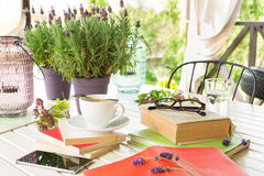 Books on the garden terrace - relaxation and reading. royalty free stock photography