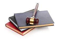 Books and gavel studio  on white Stock Images