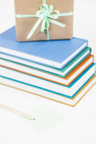 Books and gift. Multicoloured books with pencil, post-it note and handmade gift Stock Image