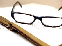 Books and Glasses. Glasses on an open book Stock Photography