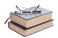 Books with glasses. Two books with glasses isolated on white background Royalty Free Stock Images
