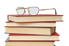 Books and Glasses. Pile of books and glasses on white background royalty free stock photos