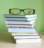 Books and glasses. Some books and glasses on a desk stock images